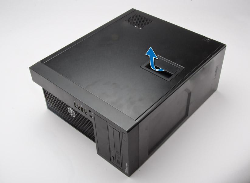 カバーをコンピューターから解除する方法を示す図。