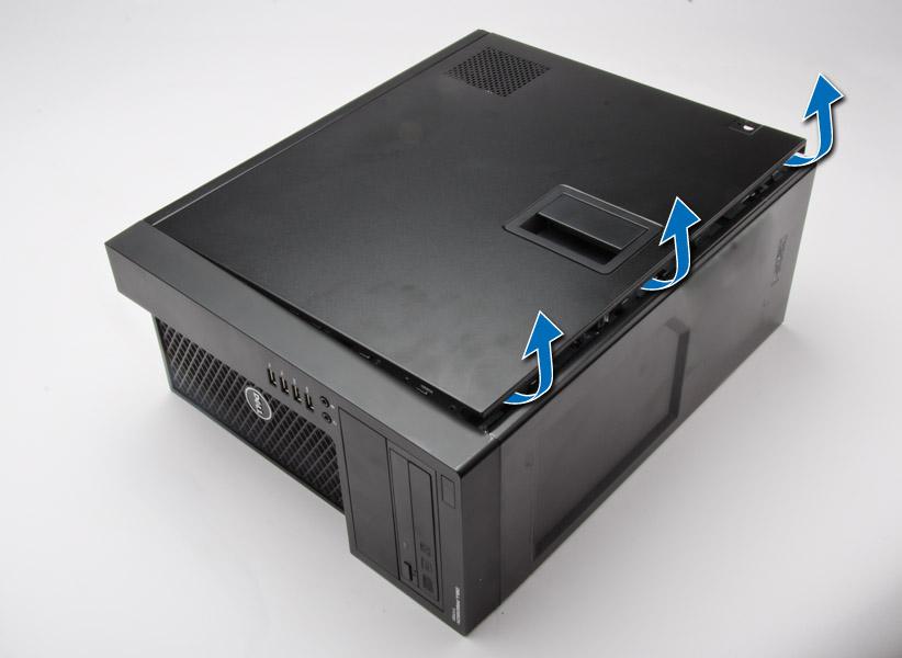 カバーをコンピューターから取り外す方法を示した図。
